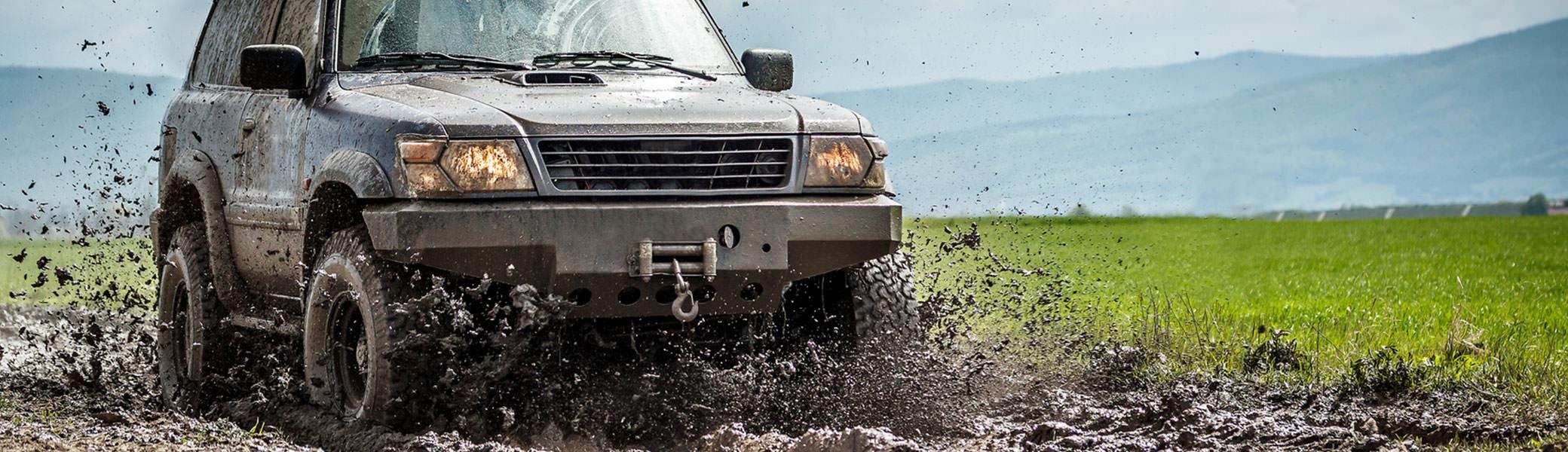 Truck splashing through the mud